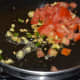 Step three: Add chopped tomatoes. Stir-cook on high flame for 2 minutes or till tomatoes become soft, yet retain crunchiness.