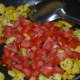 Step four: Add chopped tomatoes. Stir-cook till they become soft, not mushy.