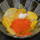 Step three: Add red chili powder and asafoetida/hing powder. Mix well.