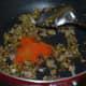 Step five: Add red chili powder, garam masala powder, cumin-coriander powder, and turmeric powder. Saute for 30 seconds.