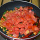 Step two: Add chopped tomatoes. Stir-cook until they become mushy