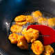 Deep-fry the cucur udang.