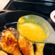 Using a spatula or spoon, pour the sauce on the chicken.