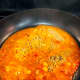 In another pan, cook the sauce.