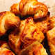 Freshly baked croissants are a beautiful golden brown.
