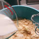 Combine the milk and water into the flour mixture.
