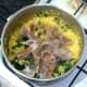 Flaked mackerel fillets and black pepper are added to the spinach and turmeric rice