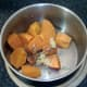 Garlic, ginger and black pepper are added to the drained sweet potatoes