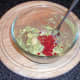 Guacamole ingredients are combined in a bowl