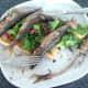 Enjoying paprika spiced sardines and chorizo salad on toast