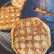 Remove the cooked waffles from the pan and continue cooking the remaining waffle.