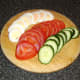 The hard boiled egg, tomatoes and cucumber are sliced as uniformly as possible