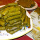Stack your finished grape leaves and continue working until you've used up all your filling