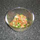 Salsa ingredients are mixed in a bowl, covered with plastic wrap and refrigerated