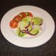 Simple salad accompanies the baked sardine