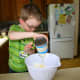 My four-year-old adds sweetened condensed milk to the cream cheese.