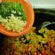 Adding the garlic, parsley, rosemary and sage
