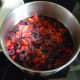 Cook the berries over medium heat until they become soft.