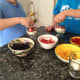 Kids have fun making their own mini trifle desserts.