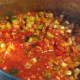 After the tomato puree has been added to the soup.