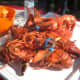 The lobsters will be a bright red color when they are fully cooked.
