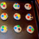 Flatten dough and add extra M&M's to top of each cookie.