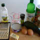 You will need to set aside the ingredients, a grater, a cutting board, a measuring cup, a pan and a bowl.