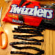 Cut 2 pieces of black licorice to create the spider legs.