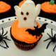 Add a ghost marshmallow and bat ring to finish the cupcake design.