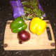 Simple salad ingredients in this instance are green bell pepper, yellow bell pepper, red onion and rocket (arugula)