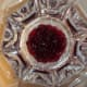 Using a clear glass bowl, ideally a trifle bowl, add ingredients in layers.  The first layer is the cranberries.
