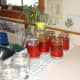 Step three: Tip the jars upside down as you finish screwing the lids on. They will sit this way for 5 minutes.