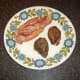 Fried bacon and pigeon breasts