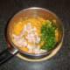 Salmon, coriander/cilantro and chilli flakes are added to sweet potato mash