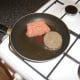 Pan frying haggis and Lorne sausage