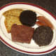 Meat and tattie scones are plated for all day Scottish breakfast
