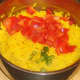 Diced peppers are added to the rice