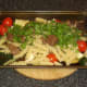 Venison, pasta and parsley added to roasted vegetables