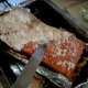 After cooking for 45-50 minutes, chisel away the layer of salt with a knife. (Excuse the blurry photo, the photographer was trembling with excitement at the sight of the rind!)
