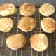 Christmas pudding pancakes are cooled on wire rack