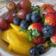 Pieces of fruit laid separately without mixing together makes an attractive fruit bowl served with any breakfast menu. Includes sliced strawberries, sliced mango, red grapes and blueberries.