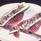 Enjoying pineapple salsa stuffed zucchini boats with gammon steaks