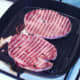 Gammon steaks are turned in griddle pan