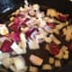 Once the butter is melted, add the onions and garlic to the pan.  Allow it to cook for a few minutes.
