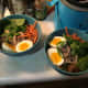 The second attempt at homemade ramen. I added mushrooms, greens, carrots, and the soft boiled egg. I also used noodles from the instant ramen packets.