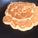 After the pancake is flipped, allow it to cook on the other side for a few minutes.  If you want to make sure that the center is done, insert a toothpick or a butter knife into the center.  If it comes out clean, your pancake is done!