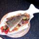 Cod fillet is laid on vegetable tagliatelle