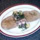 Bruschetta is plated alongside samphire salad