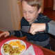 Tucking into a delicious plate of potato pancakes.
