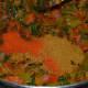 Add the spice powder and red chili powder.